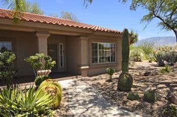 Sun City home for sale with meticulous landscaping and mountain views