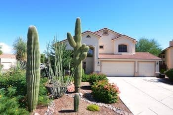 Saguaros adorn the fron yard of this Tucson home