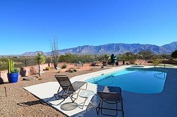 Relax Sitting Poolside looking at the Catalina Mountains